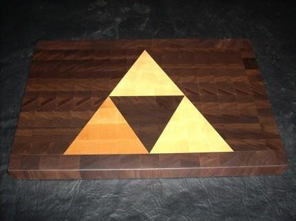 albotas:  A Little Bit on the Triforce Cutting Board Side: I enjoy cutting things. With a knife. I'm way too hardcore to use a cutting board, but for the sake of argument, if I were to buy one, it would probably be this one with a Triforce in it. It would give me the stregth, power, and wisdom to cut, chop, and dice like no other.