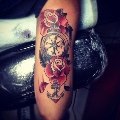 fuckyeahtattoos:  Done by True love tattoo. The meaning behind the anchor is no one will ever sink me I'm strong and I have the compass because I'm navigating myself through the obstacles of life, And roses is my middle name as well as my grandmothers name this is my 6th tattoo can't wait until I get more. #anchor #tattoo #compass #roses #traditional