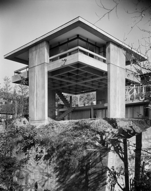 "bensasi:  sky house, kiyonori kikutake, 1958  ""Raised on stilts 20 feet high, Sky House hovers above Japan's surface, metaphorically free of its dangers and rules. Sky House grew with Kikutake's family: in 1962, the first of three capsules was plugged into the exposed underbelly of the house to accommodate new children. Kikutake later reflected that the move-nets were too small and stifled the children's activity; when British architect James Stirling came to visit, he couldn't fit down the narrow stairway into the capsule."""