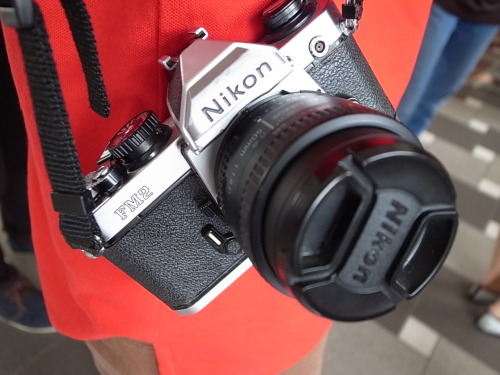 sgcamerastyle:  Singapore Camera Style Nikon FM2n + Nikon AF 50mm F1.8D Location: OH! Open House at Tiong Bahru  Remember this, qeedee? I found this tumblr account while searching for Polaroids, and did a search for the TB Open House! Aiseh, kena ambush for style blog!