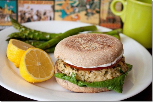 Lemon Garlic Tuna Burgers (I made these tonight and they were delicious!) makes 4 Ingredients 2, 6 oz cans tuna fish, drained and flaked  1/2 cup panko bread crumbs (did not use) 1/4 cup finely chopped green onions 3 tablespoons minced fresh parsley (did not use) 2 cloves garlic, minced   1/4 teaspoon each, salt and pepper   juice of half a lemon (used tablespoon of lemon juice) 3 tablespoons sour cream (subbed olive oil for moisture) 1 egg  4 English muffins (used whole wheat) 4 leaves romaine (subbed spinach) 1 small tomato, sliced  I also added a small amount of lemon pepper Directions Preheat oven to 400 degrees Combine all ingredients in a bowl (don't worry, it's supposed to be wet, it will cook off in the oven) Mix well with hands (I used a fork) Form into 4 patties Place patties on greased pan Cook for 20 minutes Toast english muffins and spread additional sour cream on each burger, if desired (subbed hummus) Nutrition info for 1 burger (not including bun) of original recipe:  Calories: 175.3 Fat: 3.7g Sodium: 323.4mg Carb: 9.7g Fiber 0.4g Sugars: 0.4g Protein: 24.2g source: Can You Stay For Dinner?