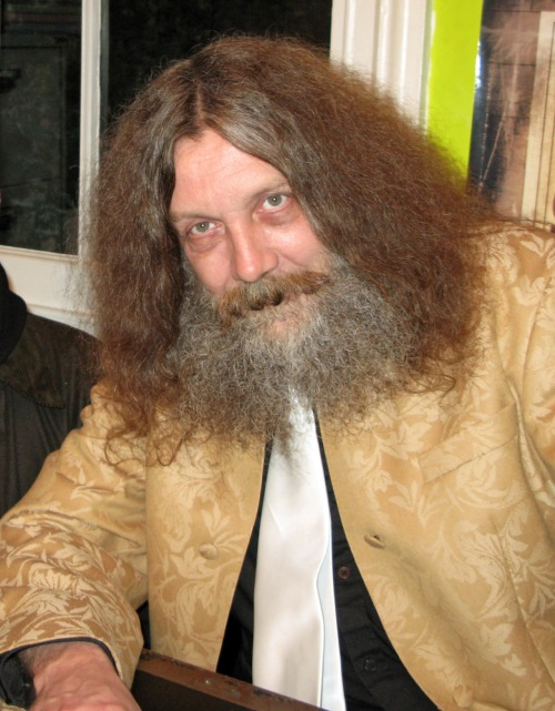 "ALAN MOORE: WRITING IS MAGIC In 1993, on his fortieth birthday, Moore openly declared his dedication to being a ceremonial magician, something he saw as ""a logical end step to my career as a writer"". According to a 2001 interview, his inspiration for doing this came when he was writing From Hell in the early 1990s, a book containing much Freemasonic and occult symbolism: ""One word balloon in From Hell completely hijacked my life… A character says something like, 'The one place gods inarguably exist is in the human mind'. After I wrote that, I realised I'd accidentally made a true statement, and now I'd have to rearrange my entire life around it. The only thing that seemed to really be appropriate was to become a magician."" Moore associates magic very much with writing; ""I believe that magic is art, and that art, whether that be music, writing, sculpture, or any other form, is literally magic. Art is, like magic, the science of manipulating symbols, words or images, to achieve changes in consciousness… Indeed to cast a spell is simply to spell, to manipulate words, to change people's consciousness, and this is why I believe that an artist or writer is the closest thing in the contemporary world to a shaman."" ""Monotheism is, to me, a great simplification. I mean the Qabalah has a great multiplicity of gods, but at the very top of the Qabalic Tree of Life, you have this one sphere that is absolute God, the Monad, something which is indivisible. All of the other gods, and indeed everything else in the universe, is a kind of emanation of that God. Now, that's fine, but it's when you suggest that there is only that one God, at this kind of unreachable height above humanity, and there is nothing in between, you're limiting and simplifying the thing. I tend to think of paganism as a kind of alphabet, as a language, it's like all of the gods are letters in that language. They express nuances, shades of meaning or certain subtleties of ideas, whereas monotheism tends to just be one vowel and it's just something like 'oooooooo'. It's a monkey sound."" Connecting his esoteric beliefs with his career in writing, he conceptualised a hypothetical area known as the ""Idea Space"", describing it as ""…a space in which mental events can be said to occur, an idea space which is perhaps universal. Our individual consciousnesses have access to this vast universal space, just as we have individual houses, but the street outside the front door belongs to everybody. It's almost as if ideas are pre-existing forms within this space… The landmasses that might exist in this mind space would be composed entirely of ideas, of concepts, that instead of continents and islands you might have large belief systems, philosophies, Marxism might be one, Judeo-Christian religions might make up another."" He subsequently believed that to navigate this space, magical systems like the tarot and the Qabalah would have to be used. Moore took as his primary deity the ancient Roman snake god Glycon, who was the centre of a cult founded by a prophet known as Alexander of Abonoteichus, and according to Alexander's critic Lucian, the god itself was merely a puppet, something Moore accepts, considering him to be a ""complete hoax"", but dismisses as irrelevant. According to Pagan Studies scholar Ethan Doyle-White, ""The very fact that Glycon was probably one big hoax was enough to convince Moore to devote himself to the scaly lord, for, as Moore maintains, the imagination is just as real as reality."""