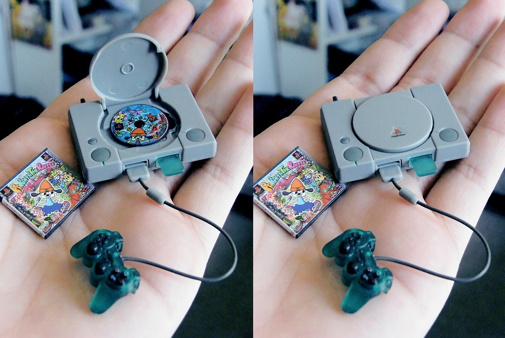 Now this is really awesome. A picture posted on Gameranx shows the tiniest PlayStation we have ever seen. It was a model created by Sebastian Vergas and even includes a mini game disc for the game Parappa the Rapper. The tiny set even has it's own controller and memory card. Cute!