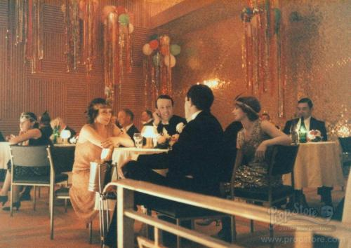 Extras in The Shining's 1921 Gold Room party sequence chat between takes. (photo courtesy Prop Store)