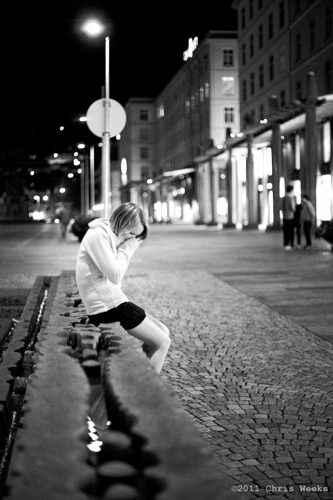 Bergen, Norway:  September, 2008.   It was late.  She was sad.  Canon 5D .  Zeiss 1.4/50 ZE.  Aperture » Silver Efex Pro 2.