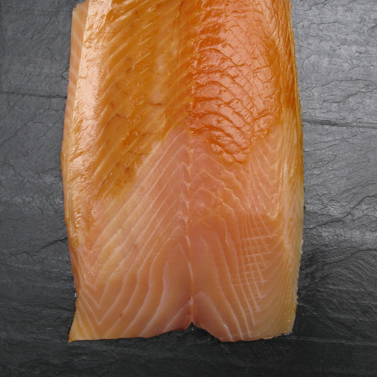 russanddaughters:  Russ & Daughters Exclusive: Wild Baltic Smoked Salmon For a limited time, food lovers will have the special chance to try a smoked salmon unlike any other; the newest catch of Russ & Daughters' Wild Baltic Smoked Salmon is finally here. (Devoted fans have been calling for months, waiting for the season to begin.) This rare gastronomic experience is available for a limited time only, so stop by the shop soon, or call us at 212-475-4880 to place an order, before it's too late. Prepare to be wowed by its elegant smoke, velvety texture, and champagne color. This salmon feeds on herring, a protein-rich diet that contributes to its lean, healthy body and signature hue, and that also provides an added bonus: an extra dose of Omega-3s. Wild Baltic Smoked Salmon is so rich and delicate that the Russ family likes it best accompanied by nothing other than a little bit of fresh black pepper. Russ & Daughters is the exclusive importer of this salmon, from a small multi-generational artisanal smokehouse on the Bornholm coast of Denmark.