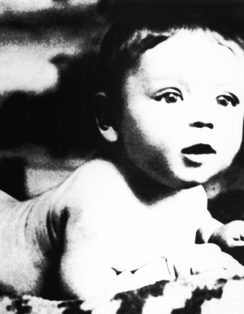 Baby Frank Sinatra, photographed just a few months after his birth, purposely at this angle so that the birth wounds on the other side of his face would not show. He was born thirteen and a half pounds to a woman less than five feet tall, and had a very difficult birth. After being pulled from his mother Dolly with forceps, he was believed to be dead and was set aside so that the nurse could try to save his mother. His grandmother swooped him up, put him under cold water and saved his life.