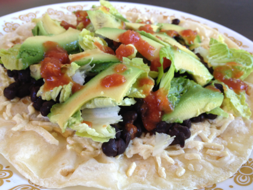 Open-Faced Vegan Quesadilla Once I transitioned from vegetarian to vegan, I realized that my burrito obsession revolved mainly around sour cream and cheese. I can make my own vegan Mexican food that's (almost) as delicious as taqueria-bought. My latest food craze is Daiya mozzarella-style shreds. They really do melt and stretch like it says on the bag! Anyhow I used Trader Joes olive oil wraps (good for mexican food as well as lentil veggie wraps etc), Daiya, organic produce and Trader Joes salsa and black beans. It was SO good and filling and satisfying. I covered it in lemon juice and nutritional yeast for extra zest. I then attempted to fold it in half, somewhat successfully. This is incredibly yummy and incredibly messy. Happy eating.  Ingredients: 1 wrap or tortilla A few tablespoons Daiya Half a can black beans Chopped romaine lettuce A few tablespoons salsa 1/4 avocado Optional: Lemon juice & nutritional yeast Directions: Put your wrap/tortilla in a pan and spread Daiya evenly, turn on medium heat. Watch it carefully because the Daiya takes a little while to melt but make sure you don't let the tortilla burn Meanwhile, heat up the black beans and chop the lettuce When the Daiya has melted, put your quesadilla on a plate and cover with beans, lettuce, avocado, then salsa and optional toppings Enjoy :) -N