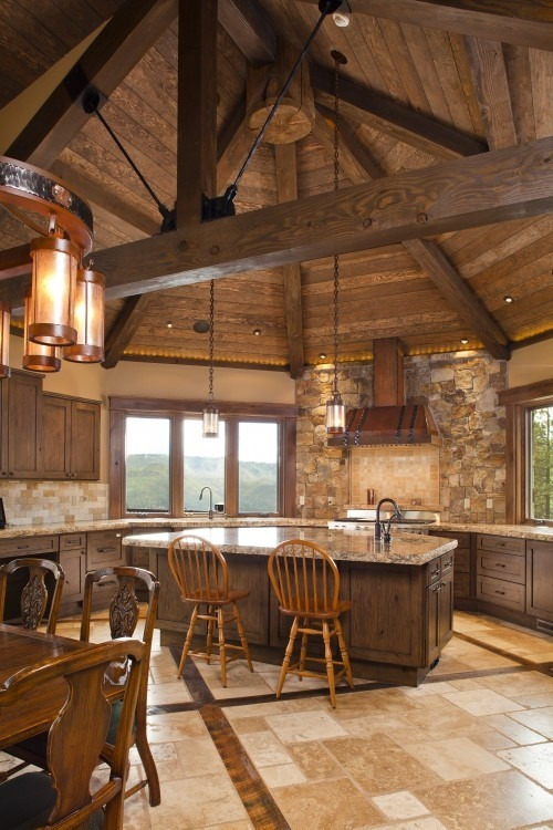 Rustic kitchen with a fabulous rounded wooden ceiling (via Pinterest)