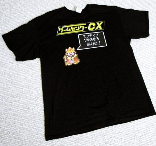 KACHO ON! Finding Game Center CX apparel on ebay is damn near impossible (but I would totally pay for a real GCCX shirt if the opportunity arose, hint hint). I took some screencaps of The King and the logo and went over them in Flash, then took the pictures onto Spreadshirt and 7-14 days later, I had me a Game Center shirt.
