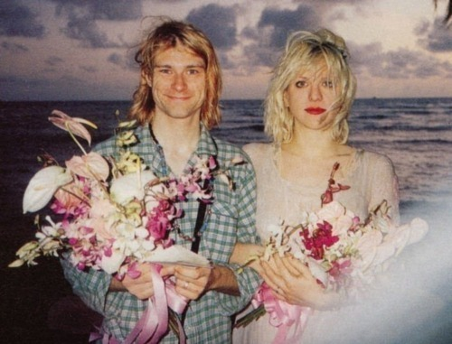 "10knotes:  ""…at our wedding, Kurt wore green pajamas because he was too lazy."" -Courtney Love This post has been featured on a 1000notes.com blog.  He looks crazy as hell when he smiles."