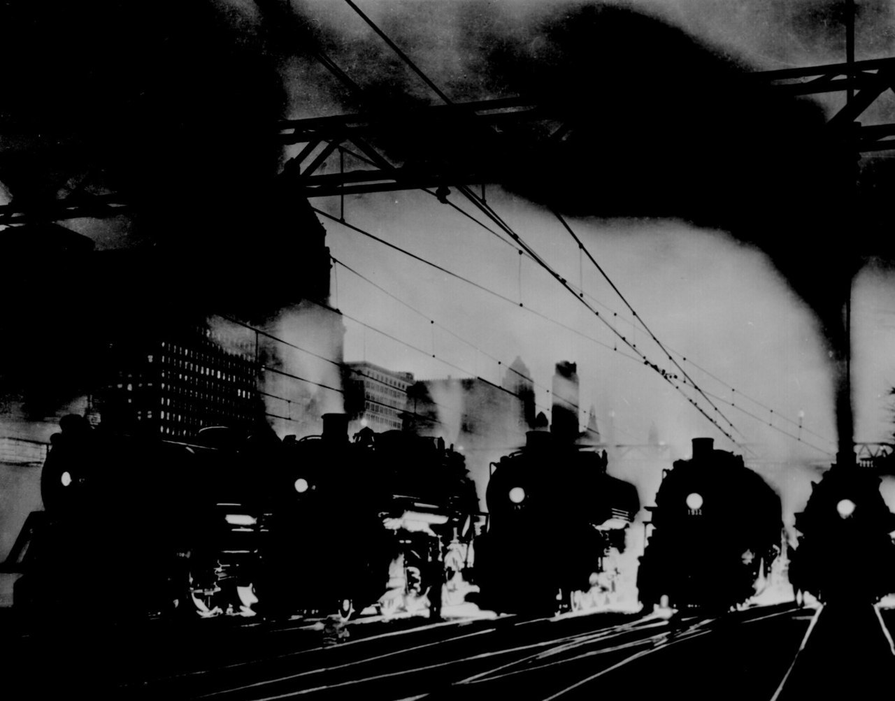 Five steam locomotives, side by side, outbound from Chicago at dusk, ca. 1940. 208-PP-24J-7.