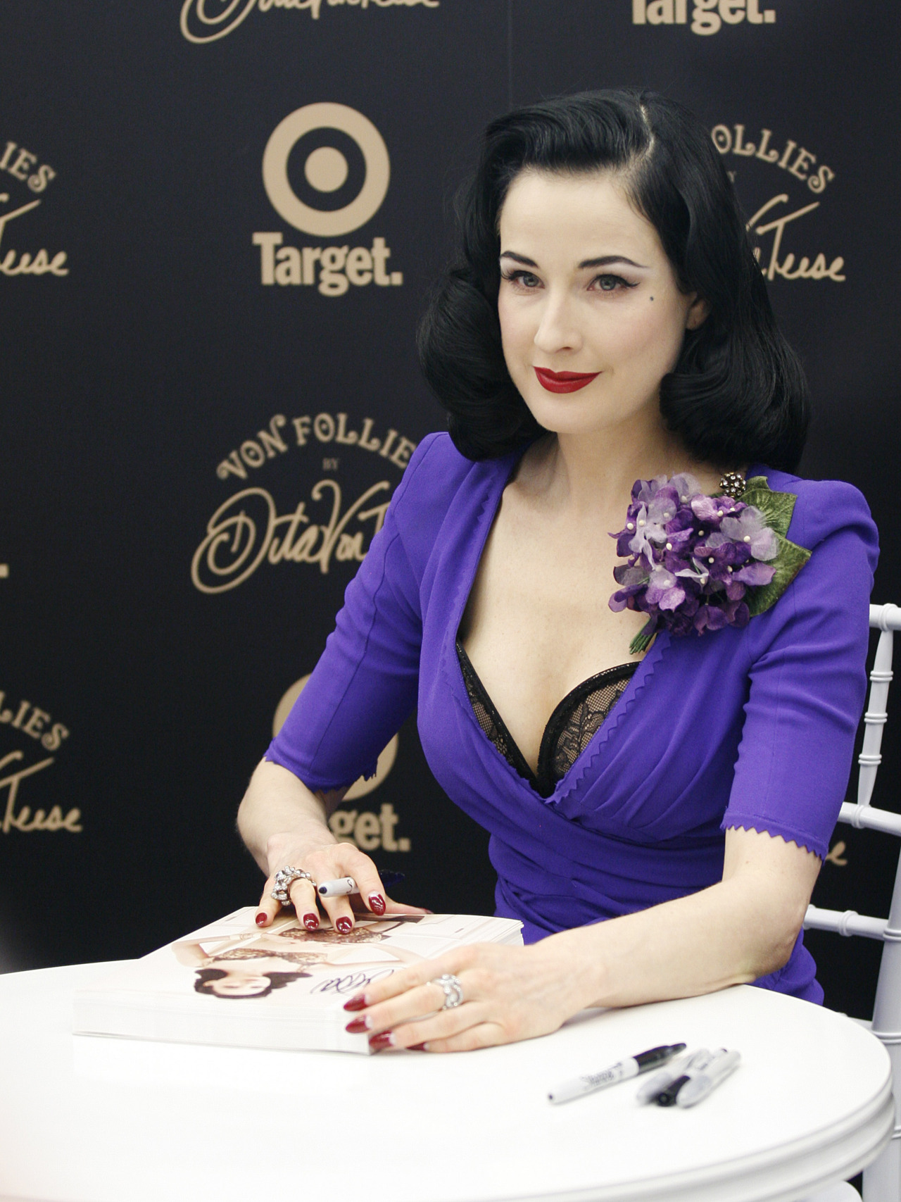 suicideblonde:  Dita Von Teese at the launch of her Von Fillies by Dita Von Teese Lingerie collection in Melbourne, March 9th  I love corsages. So elegant!