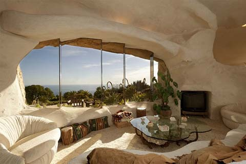 Dick Clark is one weird dude.  Apparently, he owns a one-bedroom Flintstones-inspired home in Malibu, and the LA Times reports that he's selling it for $3.5 million, though the asking price doesn't reflect the value of the home so much as it does the 23-acre plot of land it sits on.   Check out an online tour here.