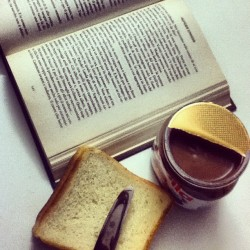While reading #hungergames #book#afternoon#snack#nutella#lovenutella#chocolate#food#reading#instadaily#instagram#instagramers#bestbookever#katniss#peetah#follower  (Taken with instagram)