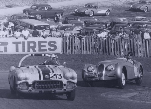 Laguna Seca, 1959. The Jaguar XK-120 chases the very mean looking Corvette on turn #9.
