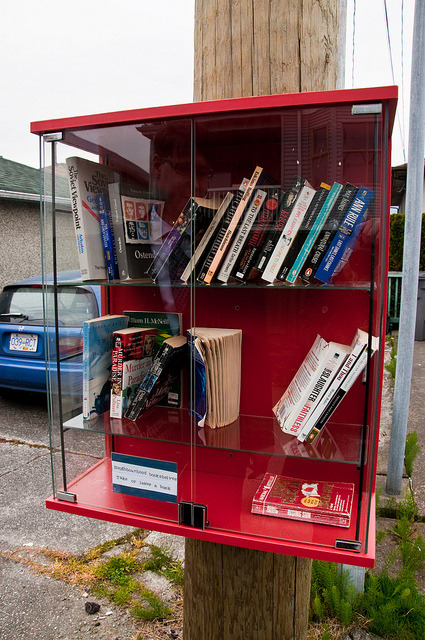 "fuzkiaha:  ""neighborhood bookshelves"" by Foxtongue on Flickr. discovered in an alley about a block from my apartment  There is still hope for the world. At least from my reader's eyes."