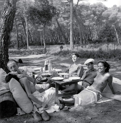"Photographer Lee Miller, poet Paul Eluard, artist Roland Penrose, artist Man Ray and model Ady Fidelin, Cannes, France, 1937 © Lee Miller Archives.   via Ady Fidelin was ""the first black model to appear in a major fashion magazine."" She was Man Ray's lover, model and muse.   via"