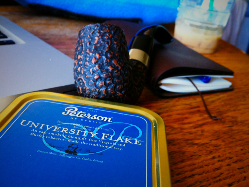isensualist:  thedanalcantara:  Today's bounty, one Peterson rusticated pipe and a tin of Peterson University Flake. The pipe definitely lived up to what I thought a Peterson would smoke like, cool and easy. The tobacco was sweet smelling and light. This is a good day.  A good day, indeed.  Kudos.