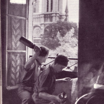 talesofwar:  Fighting with Molotovs in Front of Notre Dame de Paris, August 1944.