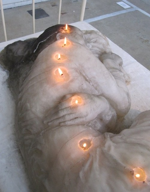 A woman made of candles, created by A.F.Vandevorst.