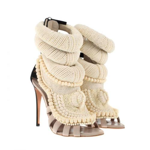 "shabazzpizazz:  Kanye West's $5,800 Giuseppe Zanotti High Heels It's no secret that Kanye West loves to design (and wear) women's clothing, so jumping into the female shoe game seems like a natural progression. Mr. West has teamed with lauded designer Giuseppe Zanotti to drop a pair of stylish new high heels. The fashion industry first saw the tan strappy, partly-beaded shoes during Paris Fashion Week last fall. Of course no one expects the self-appointed Louis Vuitton Don to charge bargain basement prices for his products, but judging by the exquisite knit embroidery alone, the shoes are worth every penny of their $5,800 sticker price. For the fashionista on a budget West is also offering a cheaper, more simplified black sandal, which will run customers only $930. Both shoes are available via the French retailer Collette. Last year Zanotti praised West for his commitment to the craft. ""[Kanye] loves learning about shoes […] both the design and construction, and we've tried to design something together,"" he said in an interview withWomen's Wear Daily. While the multi-Grammy winner received a rave from the prolific designer, the rest of the fashion world hasn't been so quick to get behind the Chicago native's vision. Critics raked the 34-year-old over the coals after debuting his line last year, and apparently unscathed by the criticism, West is back at Paris Fashion Week to debut his ready to wear line."