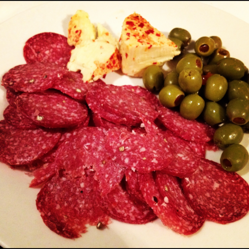 Salami, Olives and Chilli Garlic Cheese  I find that if you don't like the extremely strong taste olives have, a good way to neutralize it is to eat it with some cheese. Since cheese has more of a creamy taste rather than salty or strong, olives compliment it perfectly. I usually buy this gourmet cheese that's Chilli, Garlic and Herbs flavour and it's absolutely delicious. I don't actually like plain cheese so this one has a bit more flavour and a bit of a punch with the spice.  Try this snack out sometime =] Enjoy!