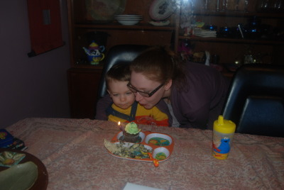 Gabby helps Bodhi blow out candles for his 2nd Bday (she wouldn't let us put up the pics of them doing Just Dance3 afterwards :)