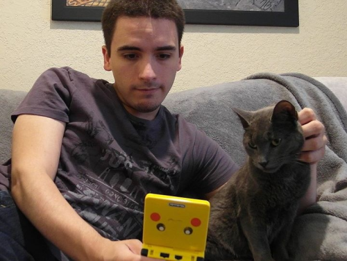 prguitarman:  A guy, a cat, and a Game Boy