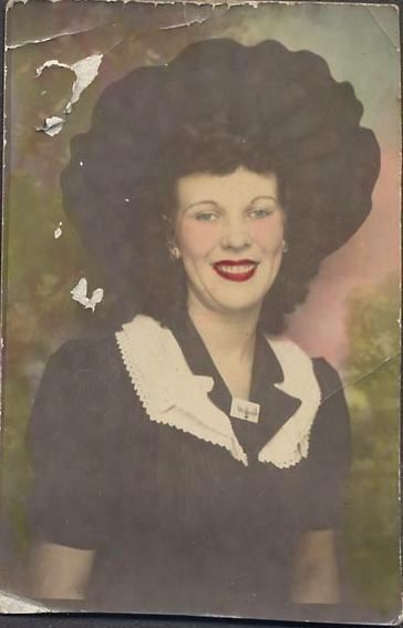 Hand tinted portrait of 1940s beauty in picture hat