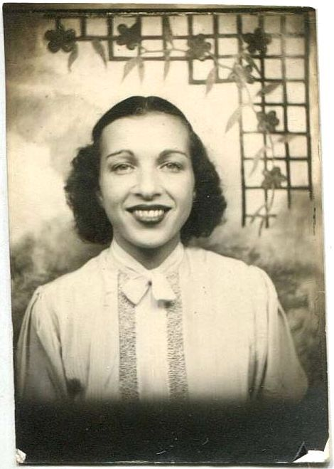c.1930s young woman against painted trellis backdrop