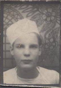 Unusual arcade portrait of young busboy
