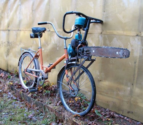 ianbrooks:  Zombie Defense Chainsaw Bike The best offense is Ghost Riding your chainsaw bike right into a zombie's decomposing face. (via: io9)