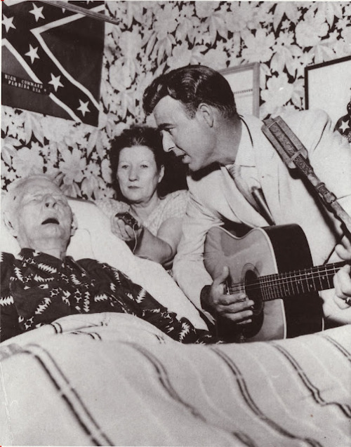 fistfullofsoul:  Johnny Horton serenades 116-year old Walter Williams, the last surviving campaigner of the Civil War.  His daughter, Willie Mae Bowles is holding the hearing aid.