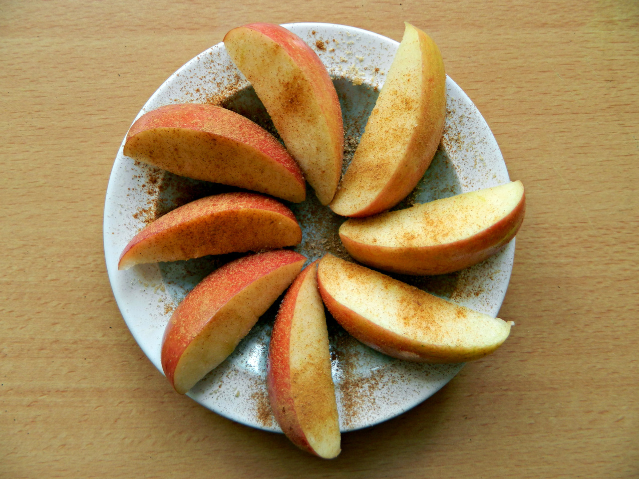 Sliced Braeburn apple with cinnamon, brown sugar and lemon juice. Dee-lish!
