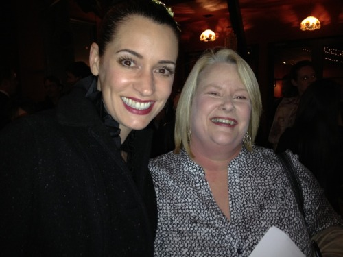 "Paget Brewster and I after the 7th Anniversary Thrilling Adventure Hour live show last Saturday night (March 3).  As so happens, Paget Brewster performs in my absolute favorite segment of the Thrilling Adventure Hour called Beyond Belief (along with Paul F. Tompkins & others).  I have laughed hysterically (usually at work) to the podcasts of the show which includes the Beyond Belief segments for a long time now.  In addition, admittedly I am a huge Criminal Minds fan since.   It was such a delightful treat to meet Paget Brewster after the Thrilling Adventure Hour show.  She was quite approachable and didn't hesitate to sign not one but two posters for me (the general show poster and then the Beyond Belief poster).  She also graciously indulged me in taking a photo.  It was truly one of the many highlights of my evening to meet her and chat briefly.   As I mentioned before, I am not an easily ""star-struck"" person and there are very few people that are famous or rather celebs that I would want to meet.  And, I do not go searching for celebs either (no, not even when I happen to visit LA).  Honestly, I was not ""star-struck"" per se to meet the actors I did after the show.  I did enjoy meeting all of them, yet was not dumbfounded or awestruck as I see others get.  They are people after all. I admit however, that it was a true highlight that the opportunity arose for me to meet an actress whose acting I enjoy and admire, Paget Brewster.   Though Paget Brewster will be missed from Criminal Minds, I truly wish her all the best and will definitely check out any future project she is involved in. I am also hoping that I can make at least one more Thrilling Adventure Hour show this year!  I do enjoy it so.  It's a long way from Florida though.  Check it out people! http://thrillingadventurehour.com/"