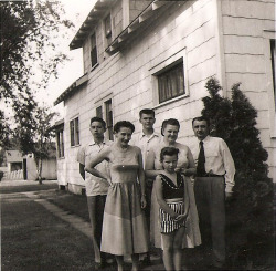 My father's family in front of their new American home in Minnesota. My dad's the skeptical young guy on the left.