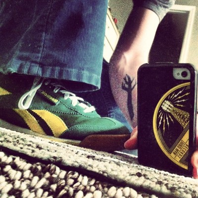hello, feet. you sure are looking spiffy today! #green / #yellow #reeboks, #thirdmanrecords #vinyl iphone case, and my simple #tree #tattoo. oh, and #blue #levis #cords. :) (Taken with instagram)