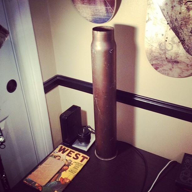 Because no desk is complete without a 30-inch WWII artillery shell. Thanks to the #rosebowlflea (Taken with instagram) Follow me at BenSuarez