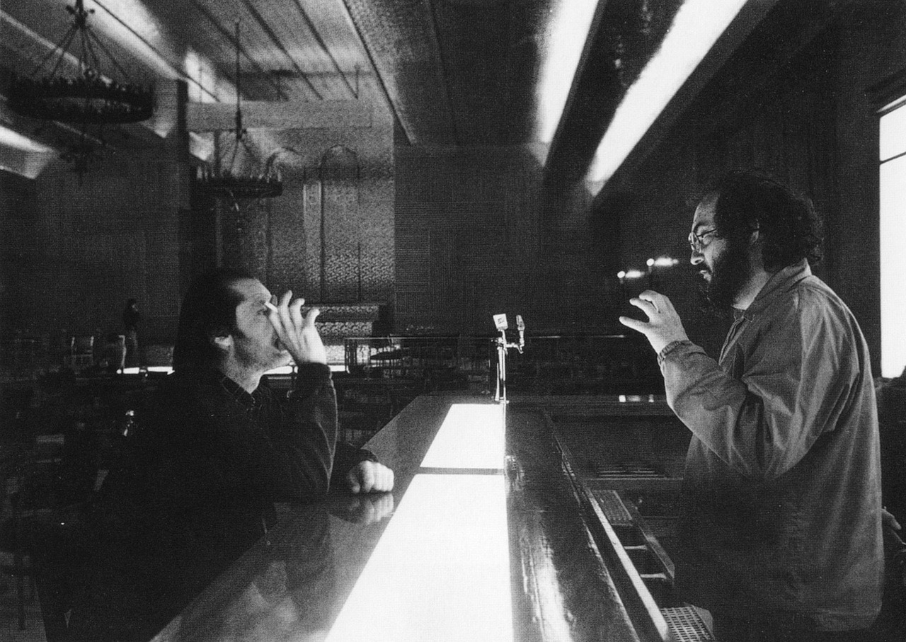 the-overlook-hotel:  Stanley Kubrick directs Jack Nicholson on the Gold Room Bar set of The Shining.