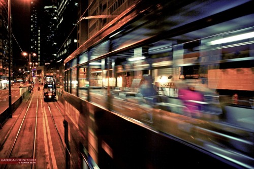 'Ding Ding' Tram by Night | Hong Kong 2008 Originally laid over a 100 years ago, the tram tracks are not unlike an ancient artery in the heart of Hong Kong, snaking from Kennedy Town in the west to Shau Kei Wan in the east. The trams with their distinctive 'ding ding' bells warning pedestrians of their impending approach are a cheap and picturesque mode of transport within the city. View the rest of the photos from my Hong Kong series.