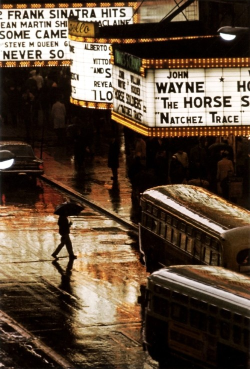 m3zzaluna:  pedestrian in rain on 42nd street, nyc, usa, 1964 photo by burt glinn, from a year in photography: magnum archive