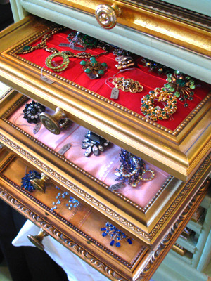 Recycled Picture Frame Jewelry Storage via Amped Dangerous I fell in love instantly when I saw this way to display jewelry. It woudn't take much but some gold paint, thrifted frames and pretty fabric. The hardest part would be the cubby for the frame 'drawers' but I bet a paper storage center would do the trick.