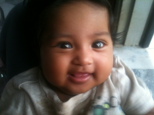 The shot that's competing in FB's The Most Photogenic Baby Contest! Click on the hyperlink to LIKE the photo for her to stand a chance to win!My Little Princess thanks ye!