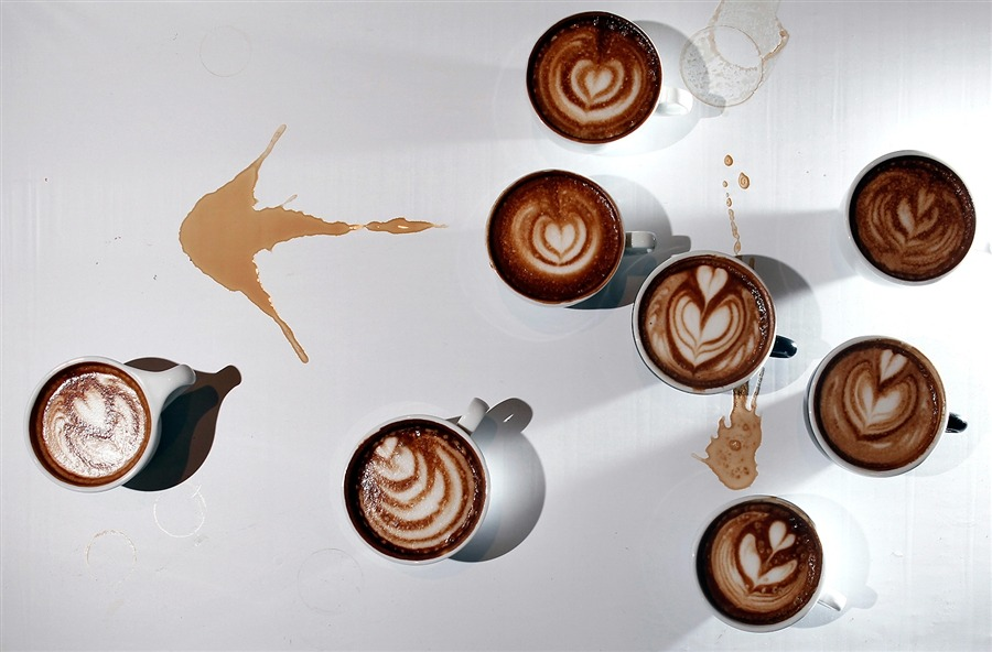inothernews:  Why just drink your coffee when you can make art out of it? Also: today I formally swear off sugar in my java.  Just Splenda, thanks very much.  Next up: milk.  I think.  Perhaps. (Photo of entries at the Coffee Fest New York Latte Art Championships on March 11, 2012 by Carlo Allegri / Reuters via MSNBC)