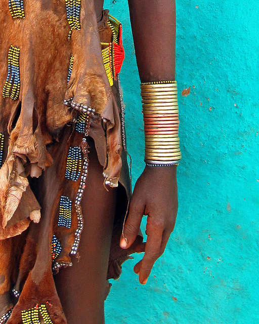 weareallafricans:  Hamar woman with copper bracelets