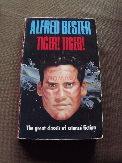 Tiger! Tiger! - Alfred Bester, 1956, This edition 1991. Also released as 'the Stars my Destination'.  I picked this up when I was 11 or 12 from one of the book sales my mum used to have with one of the choirs she attended and I just loved it. It took me quite a while to realise how 'early' (in terms of science fiction to my mind, at that age) which it was written - it had a very contemporary feel to it and made me reconsider my snobbish idea that any SF written more than ten years ago would be out of date. The story follows one Gulliver 'Gully' Foyle, a man of physical and mental potential, but, essentially, a lazy guy. 171 days stranded in his ship the Nomad, he suddenly makes contact with another craft, the Vorga-T:1339. Which instead of rescuing him, promptly leaves. he vows revenge and thus a new man is born and his tale begins.. Really highly recommended, lots of interesting ideas with a compelling main character. hardback editions now fetch rather steep prices but you should be able to find it at Amazon for a couple of bucks, at least if you settle for the import papaerback version.  -Vincent