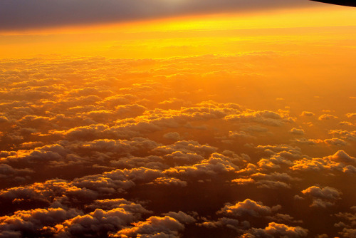 Clouds on Fire on Flickr.a photo of the 'other Dominican Sea' …a plane window's view of the sky below at sunset. March 11th, 6:27PM, Punta Cana, Dominican Republic. (shot with Canon T2i)