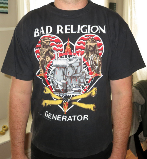 "Day: #245 Bad Religion - Generator 1992 European Summer Tour Color: Black Brand: No Tag Source: According to Wikipedia today is Generators Birthday!  20 years!  woot woot! Wow this brings back some flooding memories for me.  Getting all excited about this record.  A highly anticipated record for me to get my hands on.  the follow up to my favorite record, Against the Grain, and unbeknownst to me the last record to come out on Epitaph before they would team up with Atlantic and cross over to the major label world.  Not that that would really have any effect or bearing on my opinion of them, but it was just a turning point for that band.  the label change that is, not Generator.   I think when i bought this i wanna say the New Dag Nasty Album ""Four on the Floor"" came out about the same time, and i'll be honest i was a little saddened by that release (at that time) but i slowly came around to the kitchyness of it all later and learned to like it, not love it.  my point being is had that record been epic i might not have payed as much attention to Generator.   I focused all my attention towards Generator and really loved it.  every song almost.  It was going to be hard to follow up not only Against The Grain, but No Control, but the band seemed to put out an album that was true, honest, and in tune with the Bad Religion sound. The frist dose of this record i would get was off this split with Noam Chomsky called ""New World Order""   Not the greatest way to get people sparked on your new jam by having the B-side be a political spoken word piece, but hey, it was 1992 we needed help.  we had Bush Sr. in office, we needed all the help we can.  I think this track might have even been an alternate version if my memory serves me correctly, probably a demo version.  anyways… This record killed it.  It has been 20 years now, and it still makes me feel as good today as the day i first heard it.  by far on top 5 Bad Religion albums to own.  enjoy it.  PS did dag nasty ever tour on that record and did i Miss it?  hmmm, might be a good time to re-unite.  hey, ill even take 20 year anniversary tour of Four on the Floor!"