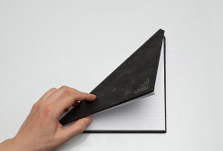 cosascool:  The Triangle Notebook by Tan Mavitan Designed by Tan Mavitan, the Triangle Notebook has a smaller size which makes it easier and more convenient to carry around. With an unconventional triangular shape, this fun notebook opens up to a square for writing. Features 144 ruled pages and a durable black fabric cover.